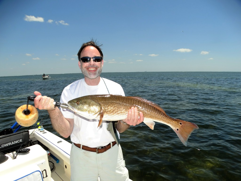 Dr. With a big redfish for the clear water area