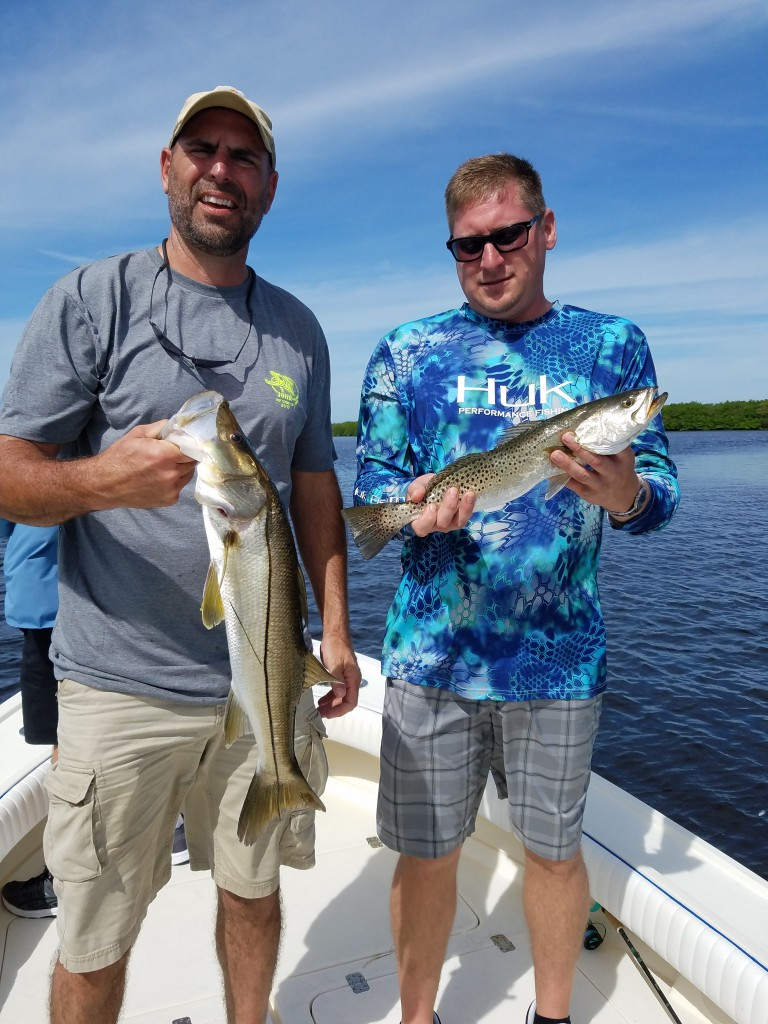John Adam with a double hook up on a fishing charter in tampa florida