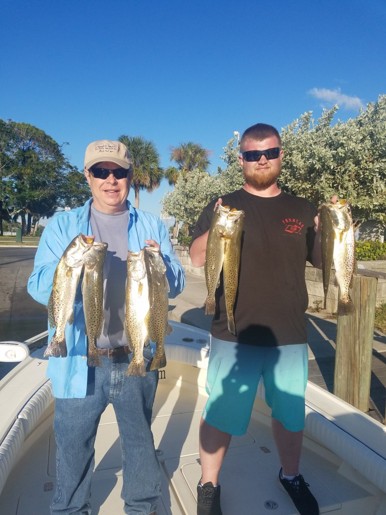 Rob and Robbie with a limit of trout caught on a guided fishing charter tour in safety harbor fl with capt.jared