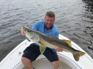 Bryan with huge snook caught while fishing with captain jared in dunedin florida