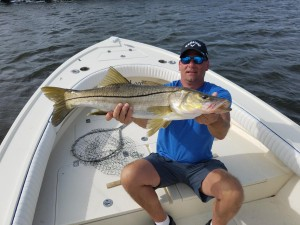 Dan with big snook caught while on a fishing charter trip with captain jared simonetti