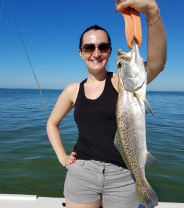 Janice with a trout caught in palm harbor while on vaction in Clearwater beach florida